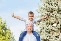Dad and son having fun outdoors. Happy family. Dad and son having fun outdoors. Human face expressions, emotions Royalty Free Stock Images