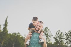 Dad with son having fun outside. Hipster style. casual clothes. concept of happy family Royalty Free Stock Photo