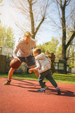 Dad and son. Dad and his son playing basketball royalty free stock photos