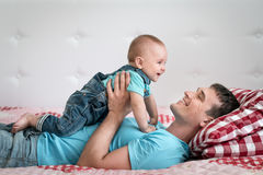 Dad and son at home Royalty Free Stock Photos