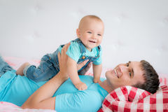 Dad and son at home stock images