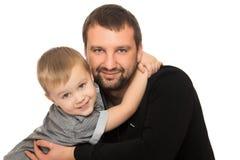 Dad and son hug Stock Photography
