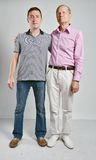 Dad and son, isolated grey background Royalty Free Stock Photos