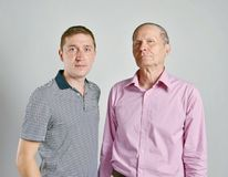 Dad and son, isolated grey background Royalty Free Stock Image