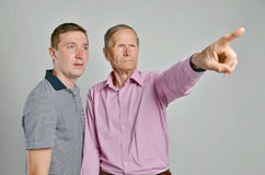 Dad and son, isolated grey background Royalty Free Stock Images