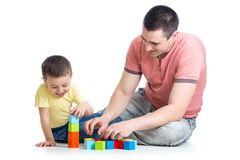 Dad and son kid playing construction game together. Dad and his son kid playing game together over white background Royalty Free Stock Images