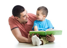 Dad and son kid reading together Royalty Free Stock Photography