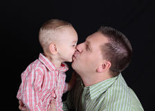 Dad and son kissed each other Royalty Free Stock Photo