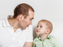 Dad and son look at one another Stock Photography