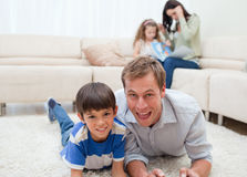 Dad and son lying on the carpet Stock Image