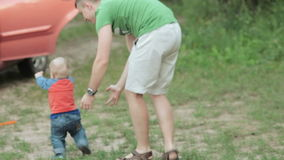 Dad and son on nature stock footage