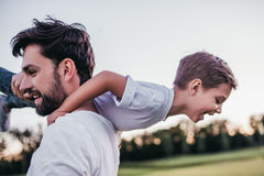 Dad and son outdoors. Dad and son having fun outdoors royalty free stock photography