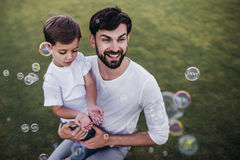 Dad and son outdoors Stock Images