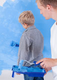 Dad and son painting wall Royalty Free Stock Photos