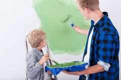 Dad and son painting wall Royalty Free Stock Image