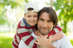 Dad and son at the park in summer Stock Photo