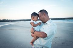 Dad and son play on the beach. Happy Dad and son play on the beach Royalty Free Stock Images