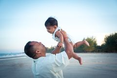 Dad and son play on the beach. Happy Dad and son play on the beach Royalty Free Stock Image