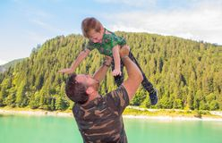 Dad and son play the plane in the mountains. A dad and son play the plane in the mountains royalty free stock image