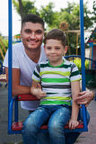 Dad and son on playground Royalty Free Stock Photography