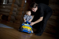 Dad and son playing Stock Images