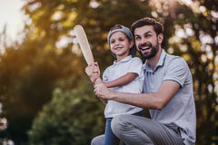 Dad with son playing baseball Stock Image