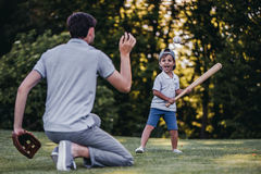 Dad with son playing baseball royalty free stock images