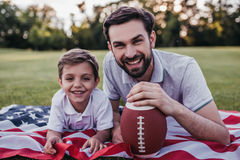 Dad with son playing baseball Stock Photos