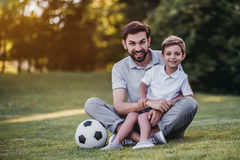 Dad with son playing baseball Stock Images