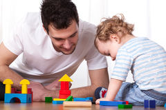 Dad and son playing with blocks Stock Images