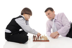 Dad and son playing chess Royalty Free Stock Images
