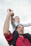 Dad and son playing. Dad holding his child on shoulders stock photo