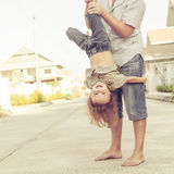 Dad and son playing near a house Stock Images
