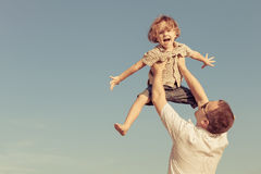 Dad and son playing near a house Stock Photography