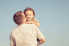 Dad and son playing near a house Royalty Free Stock Image
