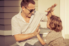 Dad and son playing near a house Royalty Free Stock Images
