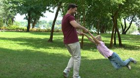 Dad and son playing in park, showing thumbs up, appreciate time with family. Stock footage stock video