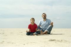Dad with son. Playing in the sand royalty free stock images