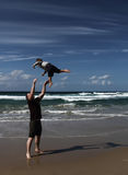 Dad and son playing on the sea Stock Photos