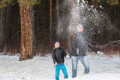 Dad and son playing in snow Royalty Free Stock Photos