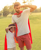 Dad and son playing superheroes Royalty Free Stock Photography