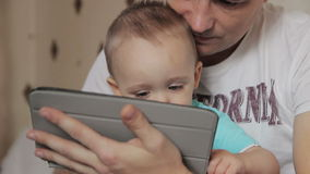Dad  and son playing on tablet stock video footage