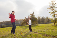 Dad and son playing. Dad playing with son throwing a paper airplane stock photos