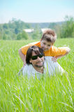 Dad and son relaxing on  grass Stock Photos