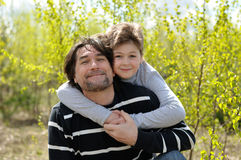Dad and son relaxing outdoors Stock Photo