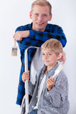 Dad and son renovating house Stock Images