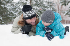 Dad and son rest in the snow Royalty Free Stock Images