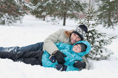 Dad and son rest in the snow Stock Images