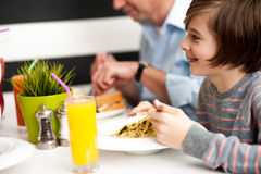 Dad and son in restaurant Royalty Free Stock Image
