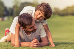 Dad and son resting outdoors Royalty Free Stock Image